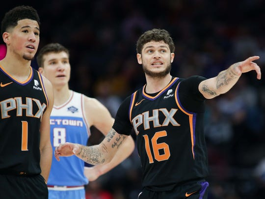 Feb 10, 2019; Sacramento, CA, USA; Phoenix Suns guard Tyler Johnson (16) talks with guard Devin Booker (1) during the fourth quarter against the Sacramento Kings at Golden 1 Center.