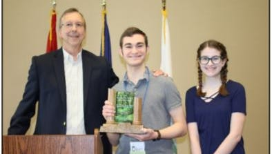 Environmental Advisory Board member Steve Robuck, left, congratulates the 2017 Small Organization Category Harry Potter Alliance/Chamber of Knowledge winners William Kindoll and Ryan Maguire.