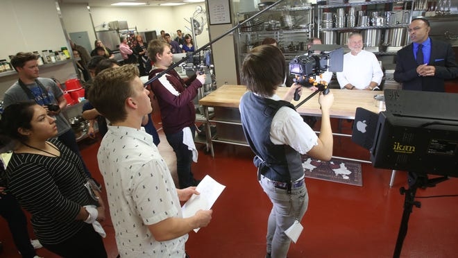 """Rancho Mirage High School student Andrei Doroshin, at center wearing white shirt, directs a 30 second commercial based off an advertisement for a television show on the Food Network called """"Chopped."""" The students are a part of an after school program run by Digicom, the rapid-growing program that uses digital storytelling as an educational tool."""