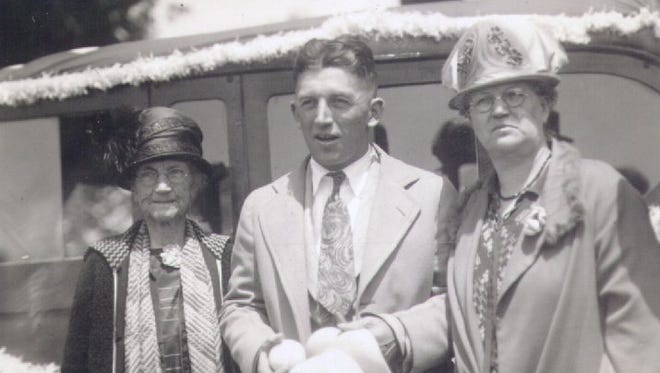 -  George Souders of Lafayette won the Indianapolis 500 in 1927. He is shown here with his mother and aunt.