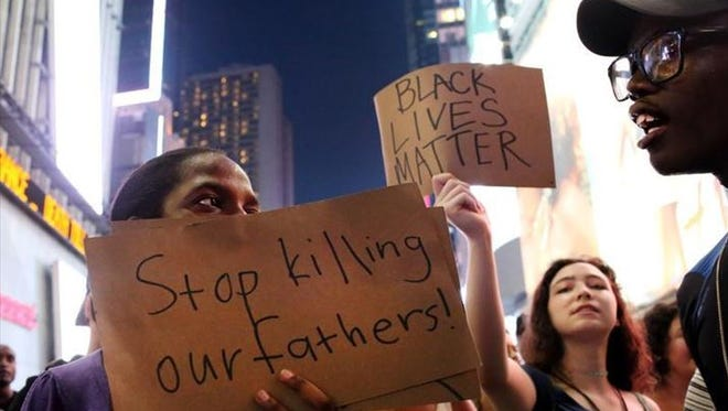 Activists protest in Times Square in response to the recent fatal shootings of two black men by police, July 7, 2016, in New York City. Protests and public outcry have grown in the days following the deaths of Alton Sterling on July 5, 2016, in Baton Rouge, Louisiana and Philando Castile on July 6, 2016, in Falcon Heights, Minnesota.