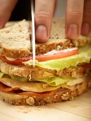 This Oct. 24, 2016 photo provided by The Culinary Institute of America shows Thanksgiving leftover turkey sandwiches in Hyde Park, N.Y. This dish is from a recipe by the CIA.
