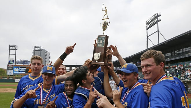 The Moeller Crusaders raise the championship trophy after the OHSAA Division I State Championship baseball game between the Moeller Crusaders and the Westerville Central Warhawks at Huntington Park in Columbu.