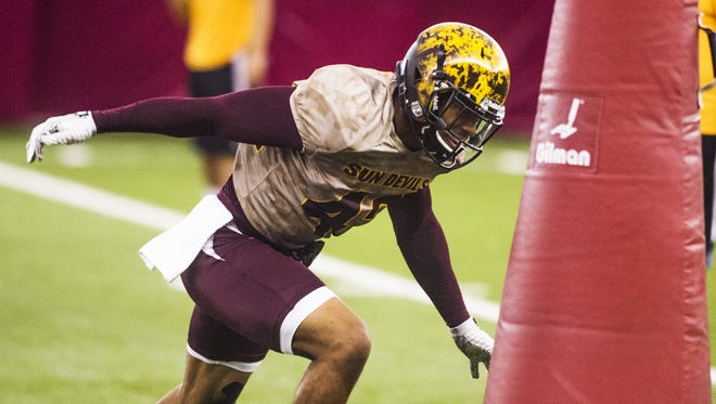 Arizona State University defensive back Lloyd Carrington hits a dummy hard during practice inside the Dickey Dome, Monday, August 10, 2015.