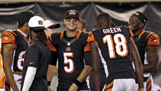 Cincinnati Bengals quarterback AJ McCarron (5) watches from the sideline after leaving the game in the fourth quarter.