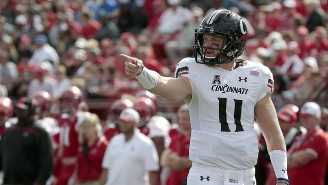 Bearcats quarterback Gunner Kiel lines up on the line of scrimmage during a wildcat play in the first quarter against Miami.