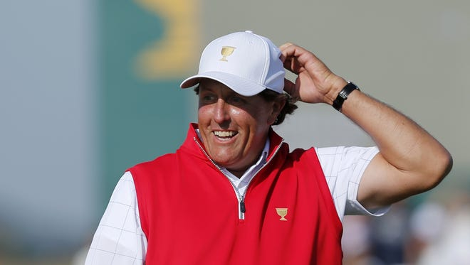 United States' Phil Mickelson reacts to his putt on the 17th green during his foursome match at the Presidents Cup golf tournament at the Jack Nicklaus Golf Club Korea, in Incheon, South Korea, Thursday, Oct. 8, 2015.