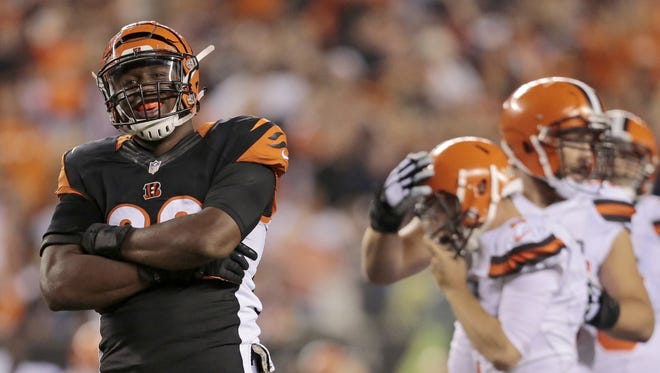 Bengals defensive end Carlos Dunlap celebrates after sacking Browns quarterback Johnny Manziel.