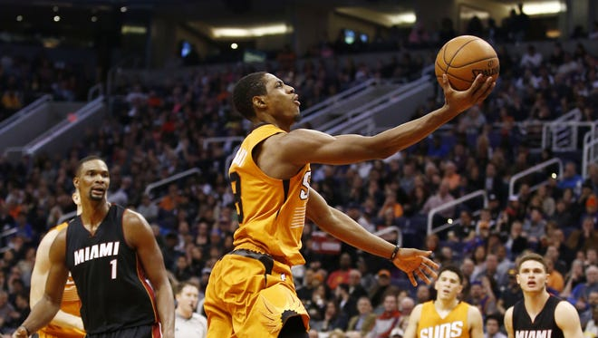 Phoenix Suns' Brandon Knight glides to the basket against the Miami Heat on Jan. 8, 2016 in Phoenix, Ariz.