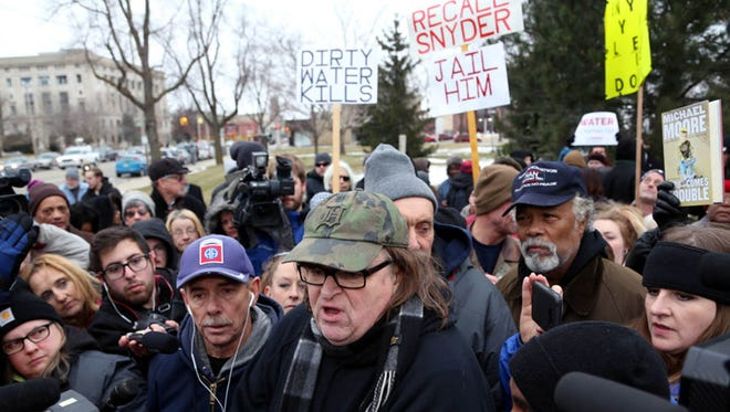 Activist, documentarian and Flint native Michael Moore addresses a large crowd Jan. 16, 2016, in Flint, Mich., about the ongoing water crisis in the city.