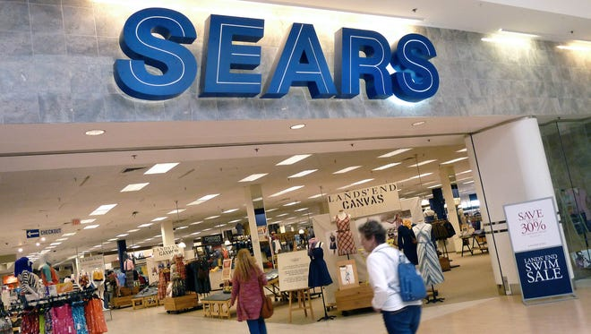 "FILE - In this May 14, 2012 file photo, shoppers walk into Sears in Peabody, Mass. After a ""challenging"" holiday shopping season, Sears is accelerating the closing of some of its stores. Shares fell nearly 3 percent in Tuesday, Feb. 9, 2016 premarket trading. (AP Photo/Elise Amendola)"
