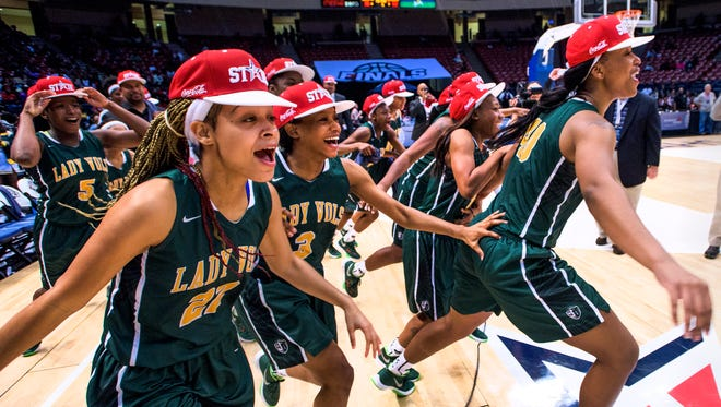 Jeff Davis players celebrate as they claim their AHSAA basketball championship trophy at Legacy Arena in Birmingham, Ala. on Saturday March 5, 2016.