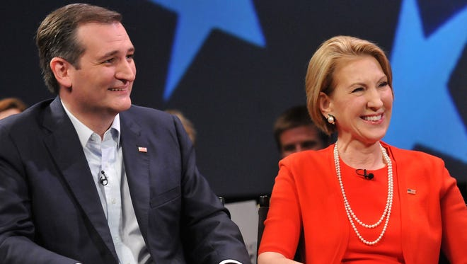 Ted Cruz and Carly Fiorina attend a discussion with political commentator Sean Hannity during a campaign rally on March 11, 2016, in Orlando.