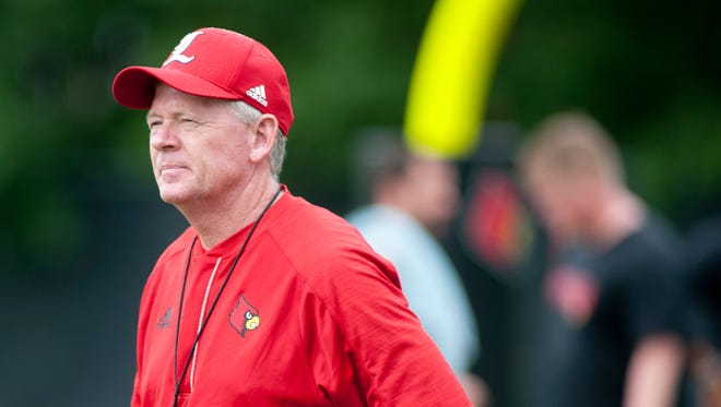 Louisville head football coach Bobby Petrino watches his team perform on the second day of afternoon practice.