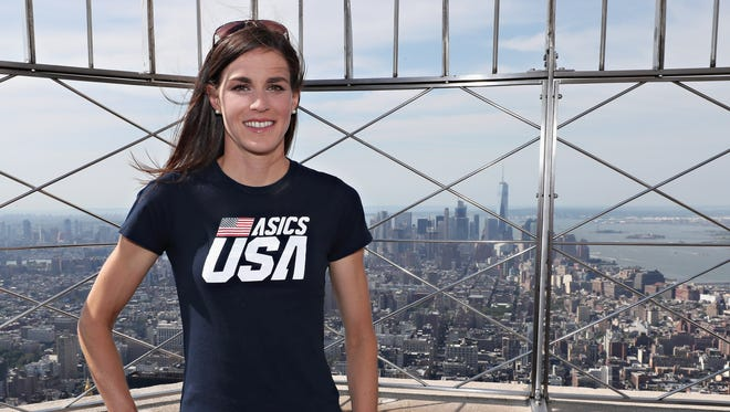 Olympic triathlon gold medalist Gwen Jorgensen poses atop the Empire State Building after announcing last month that she'll run in the New York City Marathon Nov. 6.