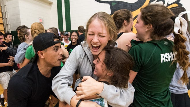 Sunnyslope players and students celebrate winning their AIA Badminton Div 2 State championships on Thursday, Oct. 27, 2016, at Sunnyslope High School in Phoenix, Ariz.