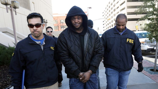 FBI Most Wanted suspect Terry A.D. Strickland was captured Jan. 15 in El Paso. Above, Strickland walks into the El Paso County Jail escorted by the FBI agents who captured him.
