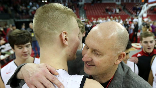 SPASH assistant coach David Hauser hugs his son Joey Hauser following their 85-56 victory over Arrowhead in the Division 1 WIAA state championship r.r in Madison, Wis.