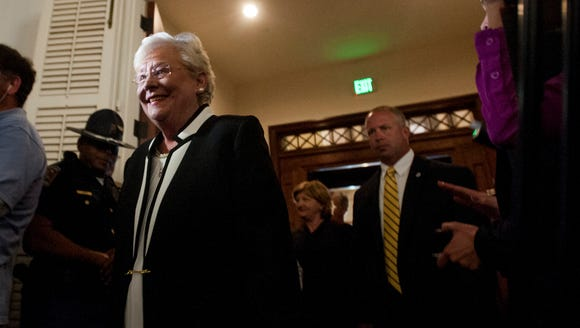 Kay Ivey arrives to be sworn in as governor at the