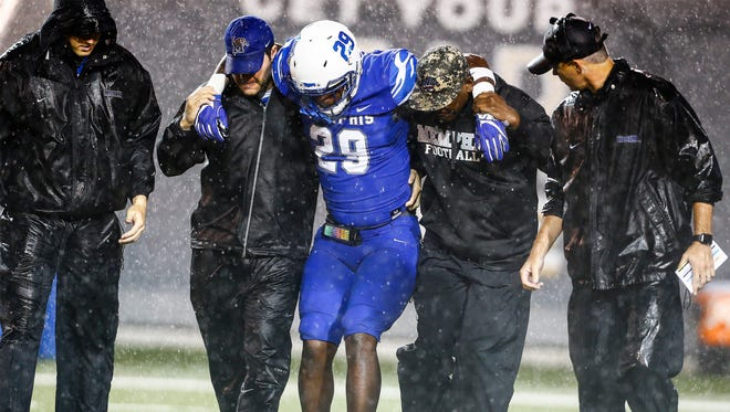 University of Memphis linebacker Darian Porter, 29, is helped off the field after substring a leg injury against University of Louisiana-Monroe during first quarter action at the Liberty Bowl Memorial Stadium.