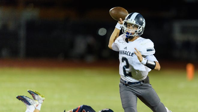 Pinnacle's Spencer Rattler(C) (#2) passes in the fourth quarter of their high school football game against Centennial on Thursday, Sept. 14, 2017, at Centennial High School in Peoria, Ariz.