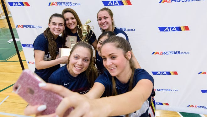 Perry's badminton team celebrates their AIA Badminton State championships on Thursday, Oct. 26, 2017, at Sunnyslope High School in Phoenix, Ariz.
