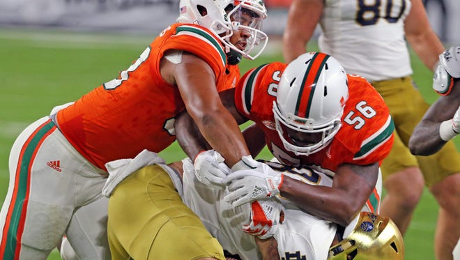 Defensive lineman Trent Harris (left) leads the Miami Hurricanes in sacks this season with 8 1/2 while linebacker Michael Pinckney (right) is third on the team in tackles with 63.