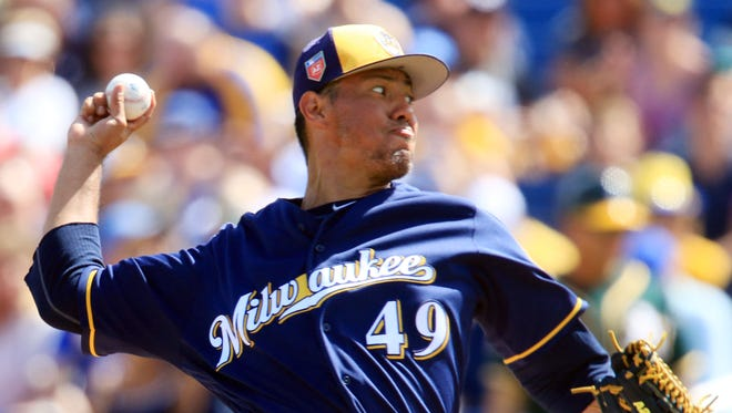 Yovani Gallardo goes three innings in a start for the Brewers against the Athletics on Friday, allowing just two runs -- both on a home run by former teammate Khris Davis in the first inning -- on three hits with two walks and three strikeouts.