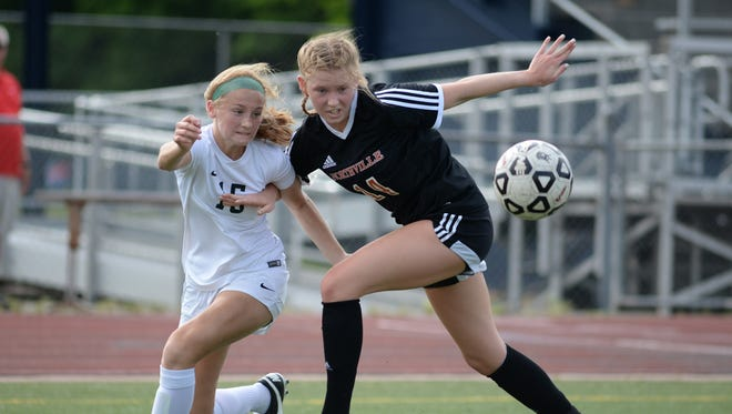 Novi's Avery Fenchel (15) and Northville's Taylor Nicholsen battle for the ball near the end of the first half of the District 8 semifinal played at Livonia Stevenson May 31, 2018.