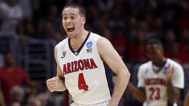 Arizona Wildcats guard T.J. McConnell (4) celebrates as the ball is called for Arizona in the second half during the NCAA West  Regional semifinal game on Thursday March 26, 2015 at the Staples Center in Los Angeles, California. Arizona won 68-60. Photo by: Mamta Popat / Arizona Daily Star