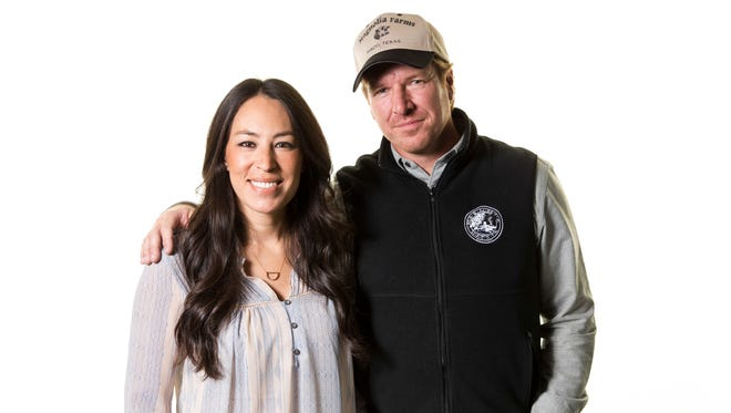 """FILE - In this March 29, 2016, file photo, Joanna Gaines, left, and Chip Gaines pose for a portrait to promote their home improvement show, """"Fixer Upper,"""" on HGTV in New York. In an interview with People magazine released on Oct. 11, 2017, the couple cited a grueling 11-month production schedule as a reason for the show's end. (Photo by Brian Ach/Invision/AP, File) ORG XMIT: PAPM103 [Via MerlinFTP Drop]"""