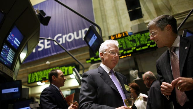 A.G. Lafley, center, chief executive of Cincinnati-based Procter & Gamble Co., on the floor of the New York Stock Exchange in 2006 before being given the CEO of the Year Award from Chief Executive Magazine.