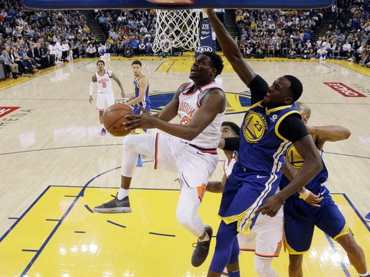 Phoenix Suns' Danuel House Jr., front left, drives past Golden State Warriors' Draymond Green (23) during the first half of an NBA basketball game Sunday, April 1, 2018, in Oakland, Calif. (AP Photo/Marcio Jose Sanchez)
