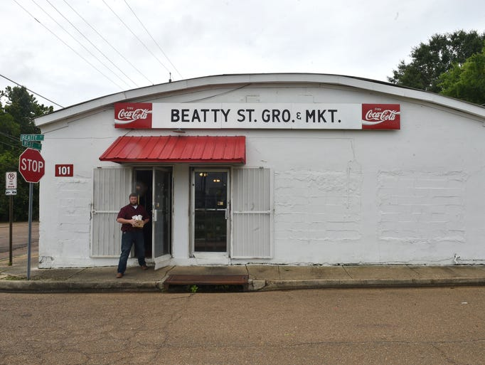 A man walks out of Beatty Street Grocery in Jackson.