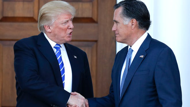 In November 2016, President-elect Donald Trump and Mitt Romney shake hands as Romney leaves the Trump National Golf Club Bedminster in Bedminster, N.J.