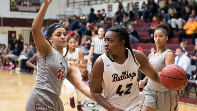 Bearden's Jakhyia Davis is defended by West's Madi McCoy in a game Jan. 9.
