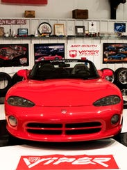 A 1993 Dodge Viper sits in the garage at Dolph Williams'