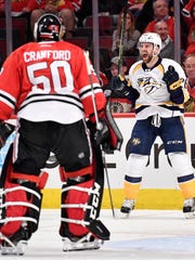 Nashville Predators left wing Harry Zolnierczyk (26) celebrates his goal in front of Chicago Blackhawks goalie Corey Crawford (50) in the second period of game two in the first-round NHL playoff series at the United Center, Saturday, April 15, 2017, in Chicago, Ill.