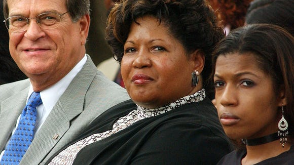 Former Sen. Trent Lott, Reena Evers-Everette, daugter of slain civil rights leader Medgar Evers, and her daughter Cambi Evers-Everette, attend a ceremony at Medgar Evers's gravesite in Arlington National Cemetery in 2003.