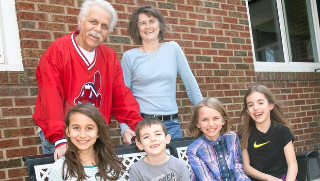 Michael Follett stands with his wife Nancy and his grandchildren (left to right) Ava Cline, 10; Mason Follett, 6; Natalie Cline, 9 and Morgan Follett, 9.