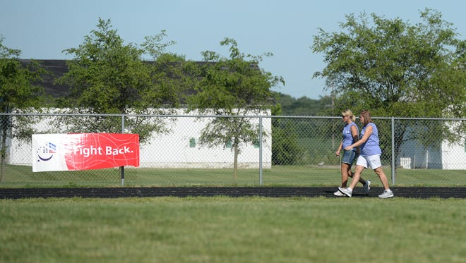 Walkers complete laps during the 2014 Union County Relay for Life in Liberty, Ind.
