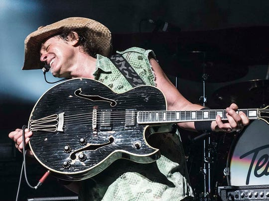 "Ted Nugent performs in the 2014 ""Shut Up & Jam"" tour."