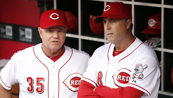 Cincinnati Reds third base coach Steve Smith (35) and Cincinnati Reds manager Bryan Price (38) get together.