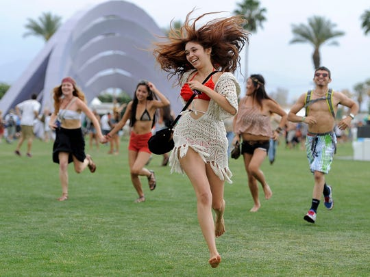 This April 13, 2012 file photo shows festivalgoers running toward the main stage to catch the beginning of Kendrick Lamar's set during the first weekend of the 2012 Coachella Valley Music and Arts Festival in Indio, Calif.