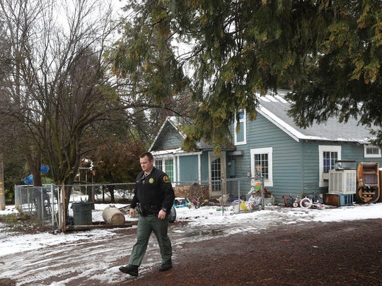 Shasta County Sheriff's Deputy Chris Wright leaves a house in Burney, Monday, after a post interview for a case. Wright is a deputy at the Burney substation and a resident in Burney.