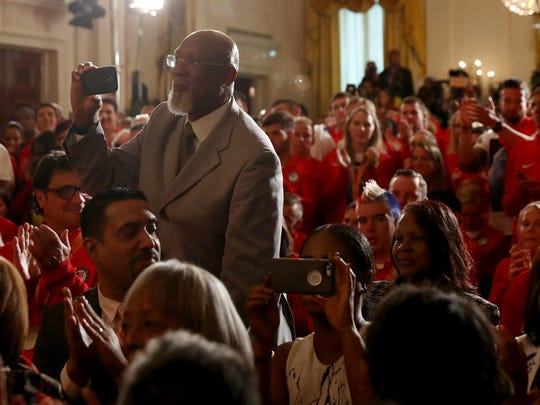 John Carlos, 1968 U.S. Olympian takes a picture with his cell phone during the East Room event as President Obama and first lady Michelle Obama welcome the 2016 U.S. Olympic and Paralympic teams to the White House to honor their participation and success in the Rio Olympic Games this year.