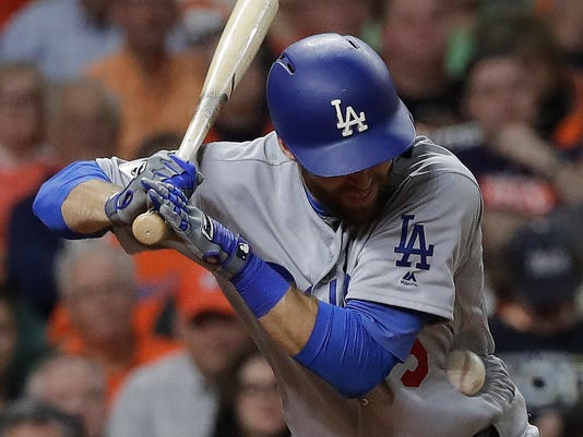 Los Angeles Dodgers' Chris Taylor is hit by a pitch during the eighth inning of Game 5 of baseball's World Series against the Houston Astros Sunday, Oct. 29, 2017, in Houston. (AP Photo/David J. Phillip)