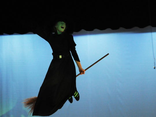 "As the Wicked Witch of the West, Michaela Kraft soars through the air searching for Dorothy, and her little dog, too, in a scene from the Southern Door High School musical production of ""The Wizard of Oz."""