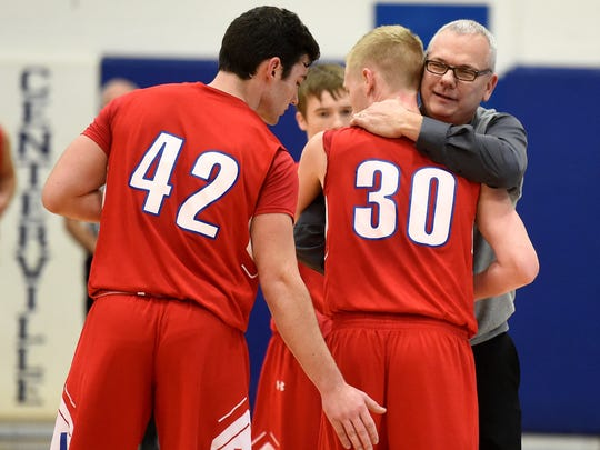 Union County's Logan Sanford is congratulated by coach Mark Detweiler and teammates after scoring his 1,000th point during a boys basketball game Wednesday, Jan. 25, 2017 in Centerville.