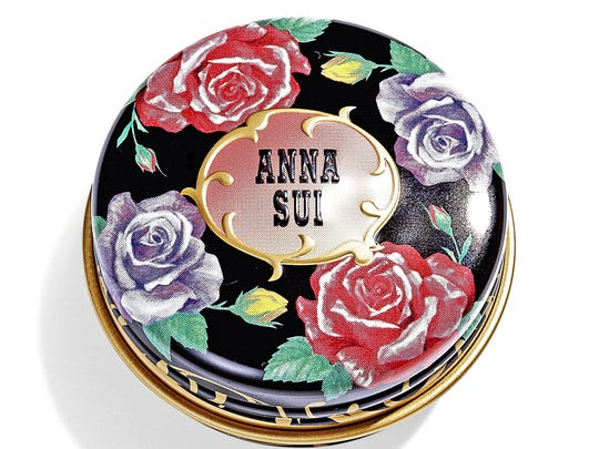 A rose motif tin of lip balm by designer Anna Sui.